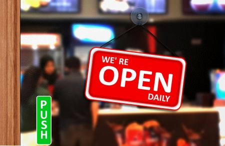 We are open daily sign on shop glass door 写真素材