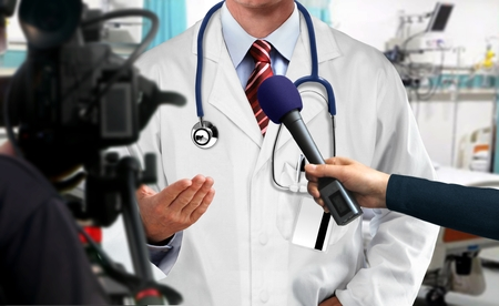 Press interview with medical doctor 写真素材