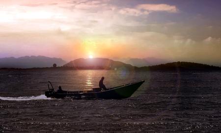 Small fishing boat at sunrise 写真素材