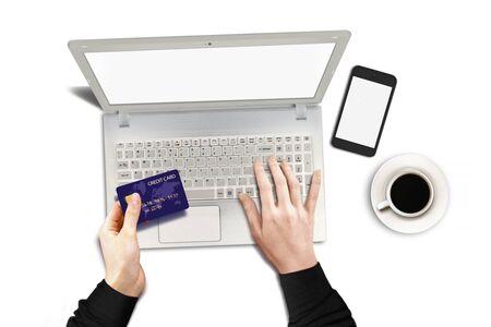 クレジット カードとノート パソコンを使用してオンラインで購入 写真素材