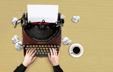 Women hands using vintage typewriter 写真素材