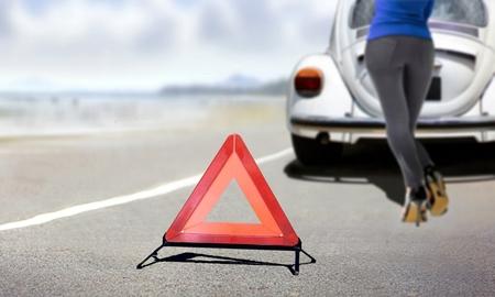 Women pushing a car during break down to roadside