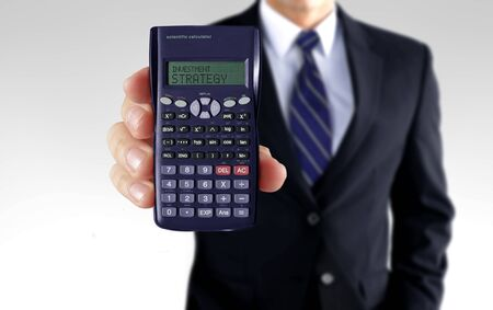 Men holding calculator showing investment strategy