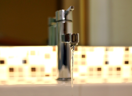 Open tap water with chrome faucet 写真素材