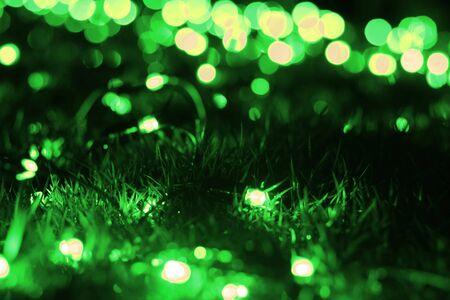 Green blur lights bokeh on grass