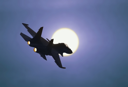 Jet fighter flying under sunlight