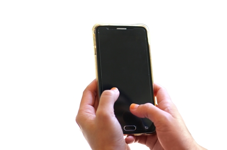 Hand holding smart phone over white