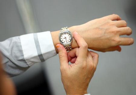 Women checking on time at her wrist watch