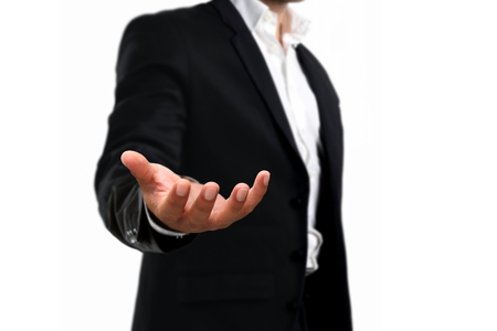 business man in black suit with an open hand 写真素材