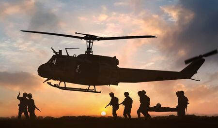 Military rescue helicopter during sunset Banque d'images