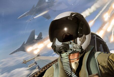 Pilot cockpit view during air to air combat with missiles flares chaff being deployed Reklamní fotografie