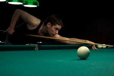 Young man playing russian billiards photo