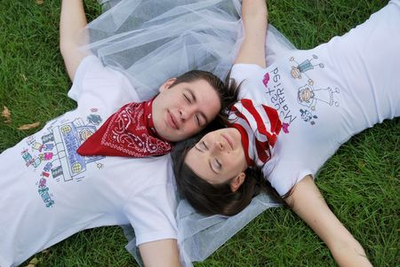 Just married couple dreaming on the grass