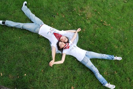 married couples: Just married couple dreaming on the grass