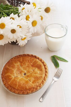 Apple pie, milk and chamomiles  photo