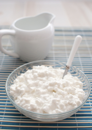 Cottage cheese in glass bowl  Stock Photo