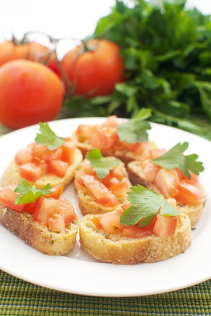 Crostini with tomatoes and parsley  photo