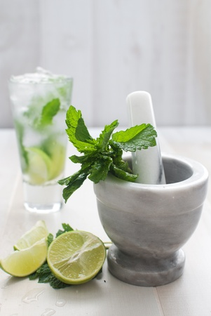 Lime and mint drink with mortar and pestle vertical  photo