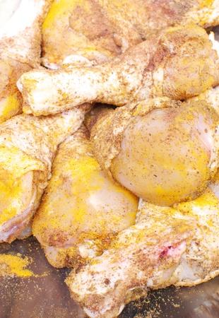 Chicken drumsticks marinating in spices  photo