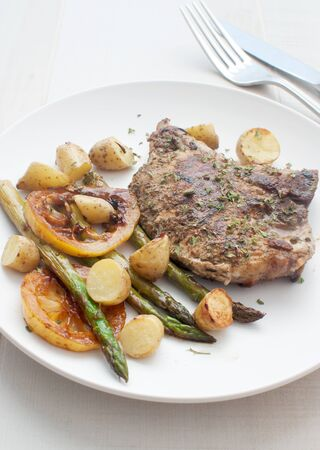 Grilled pork, asparagus and young potatoes  photo