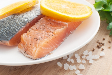 salted salmon fillets with oranges  photo