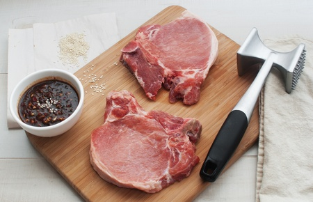 Preparing raw meat for cooking Stock Photo