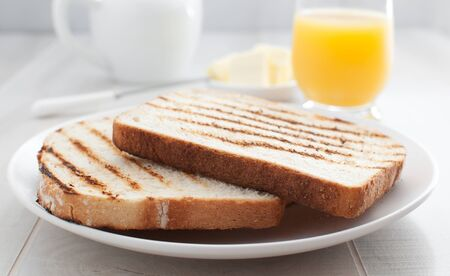 morning toast bread with butter and juice   photo