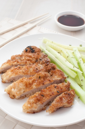 breadcrumbs: Pork fried in breadcrumbs with cucumber