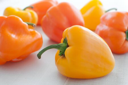 Bright yellow bell peppers horizontal photo