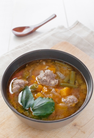 Soup with vegetables and meatballs vertical photo