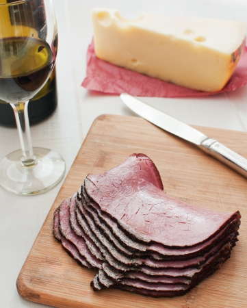 Sliced pastrami deli meat and wine and cheese Stock Photo - 15608512