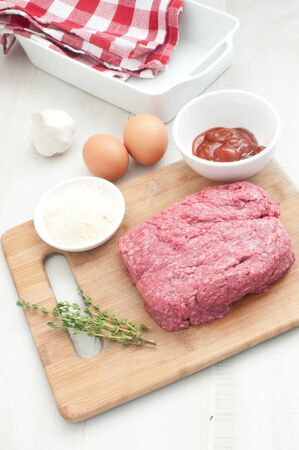 Ingredients for making meatloaf vertical photo