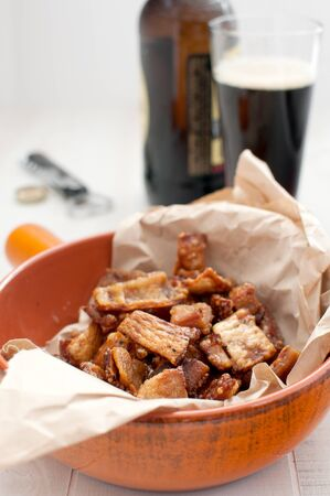 Beer snack of fired crackling pork skin vertical photo