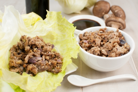 Ground chicken and mushrooms for lettuce wraps horizontal photo