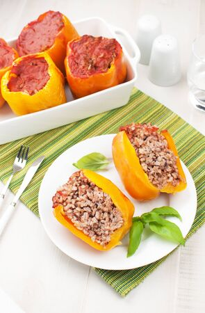 Baked bell pepper stuffed with rice and ground meat photo