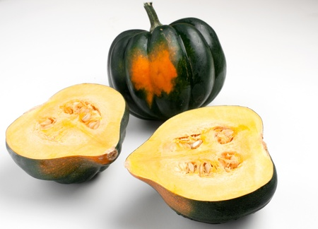 Acorn squash halves  and whole on white