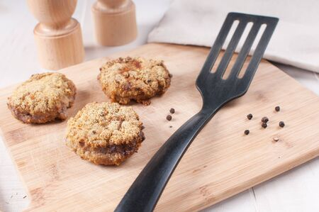 breaded pork chop: Fried meat cutlets (patties) with spatula horizontal Stock Photo
