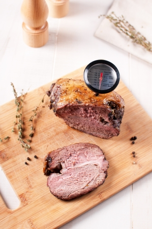 roast lamb: Roasted lamb meat with meat thermometer