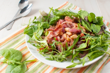 Beans and prosciutto salad with sun dried tomatoes Stock Photo