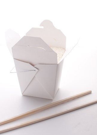 unprinted: Take-out box with rice with chopsticks isolated