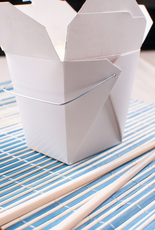 unprinted: Rice in take-out box from chinese restaurant and chopsticks Stock Photo