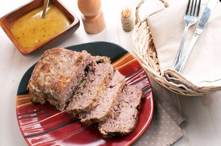 Meatloaf with garlic gravy sauce photo