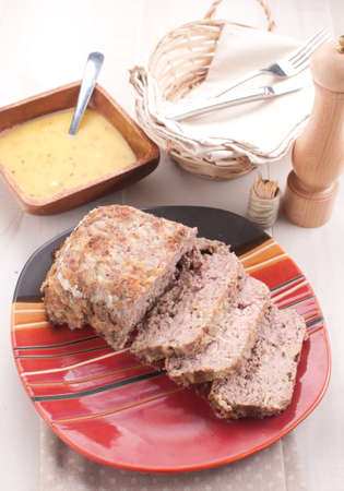 Homemade meatloaf with garlic sauce vertical photo