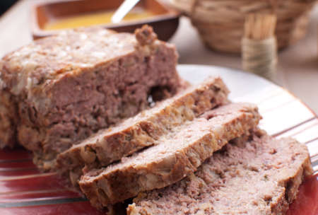 Sliced meatloaf closeup on red plate Stock Photo - 17707820