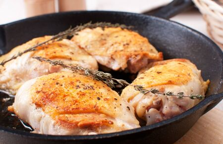 Golden crisp chicken thighs with herbs and spices horizontal photo