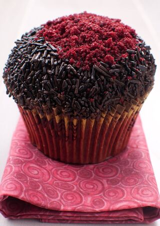 Closeup muffin with sprinkles and red sugar decoration Stock Photo