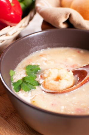 Bowl with shrimp and vegetables soup vertical photo