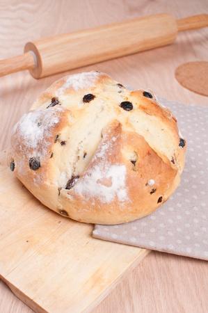 bread soda: Traditional irish soda bread with raisins on the wooden board Stock Photo