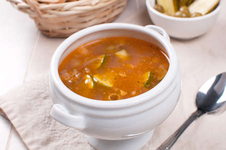 soljanka: Tomato soup with fish, olives and lime horizontal