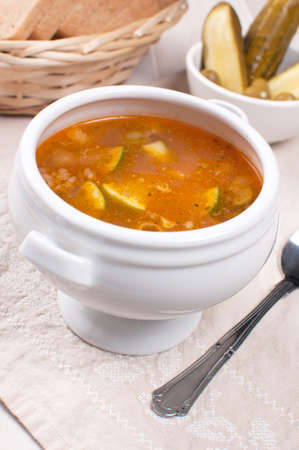 soljanka: Tomato soup with pickles and olives and lime